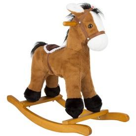 Dřevěný houpací kůň se sedlem